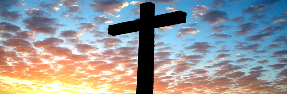 cross and sunset sky